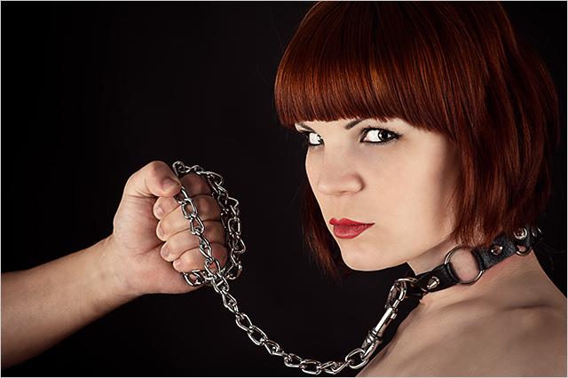 Switch and reverse roles. Woman with collar and chain.