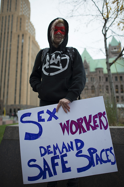 Activist for sex worker rights with poster