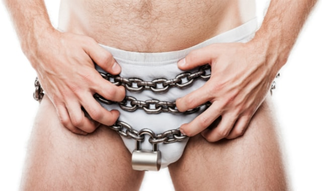 Man wearing chains like a chastity belt and white underwear