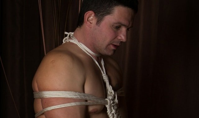 Male submissive bound with rope
