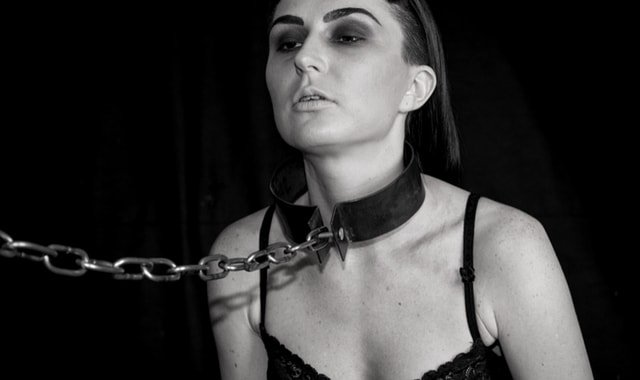 Woman in collar and chain | Fetish.com