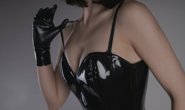 Woman wearing rubber fetish gloves
