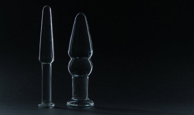 Image of two butt plugs on black background