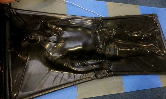 Restrained in a latex vacbed
