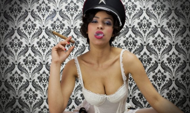 woman smoking a cigar wearing lingerie