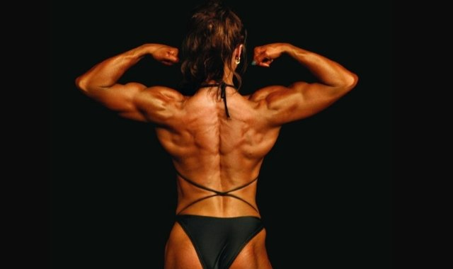 Female Bodybuilder. Image by roonb [CC BY 2.0], via Wikimedia Commons