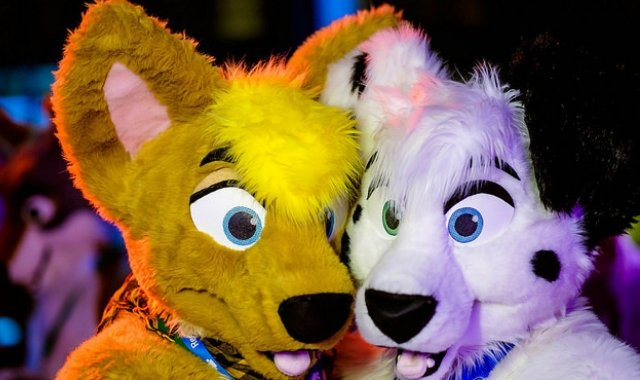 Image of two furries at a conference